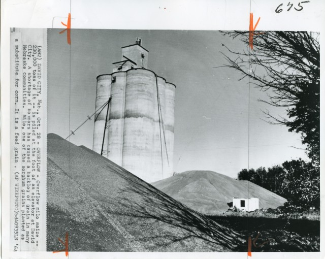 A historical image taken in David City, dated October 28, 1964. This is not the Tillotson Construction elevator, but it's neighbor a short distance down the rail line.
