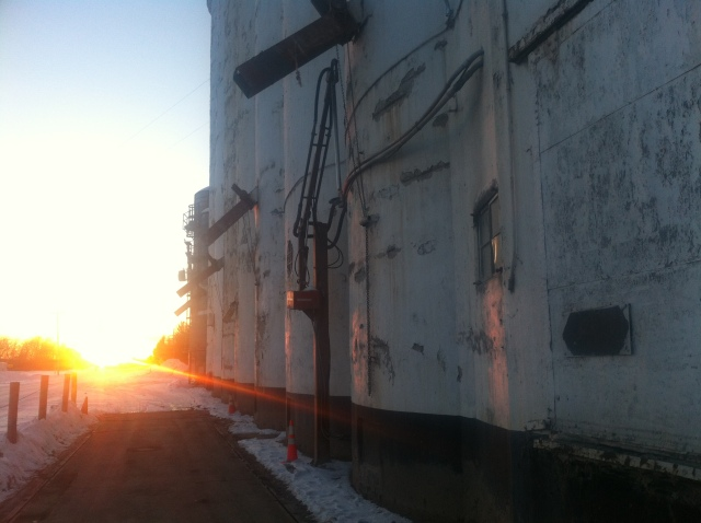Along Chelsea Dexter Road in Washtenaw County, Mich., the sun bids farewell to an elevator. Watch for our next post, scheduled for Monday, to learn more details about the elevator. Photo by Ronald Ahrens
